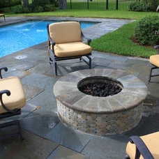 Traditional Patio by Pools by John Clarkson