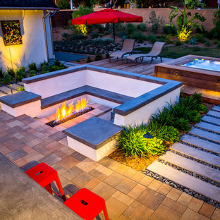Patio - large contemporary backyard concrete paver patio idea in Tampa with a fire pit and no cover