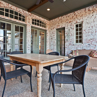 Inspiration for a timeless patio remodel in Dallas with a roof extension
