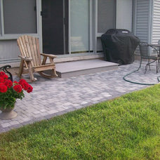 Patio by custom landscape & patio