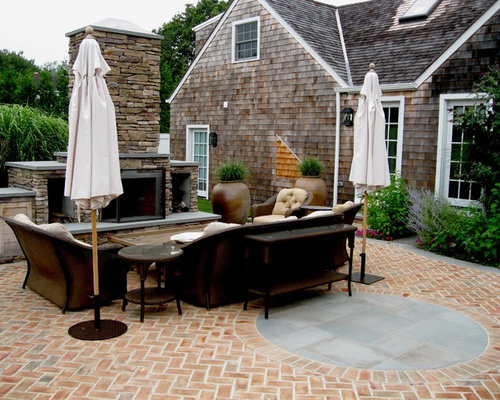 Elegant Stone Patio Photo In New York With A Fire Pit