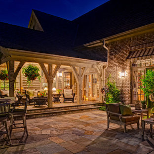 Patio - traditional backyard patio idea in Chicago with a pergola
