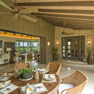 Inspiration for a tropical patio remodel in Hawaii with a roof extension
