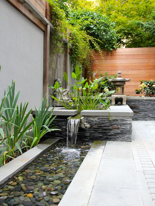 Example Of A Small Courtyard Stone Patio Fountain Design In DC Metro