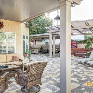 Photo of a traditional patio in Orange County with concrete paving and an awning.