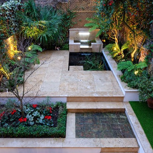 Design ideas for a small classic back patio in London with a water feature and natural stone paving.