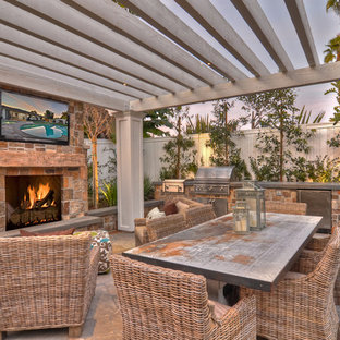 Patio - transitional patio idea in Orange County with a fire pit and a pergola