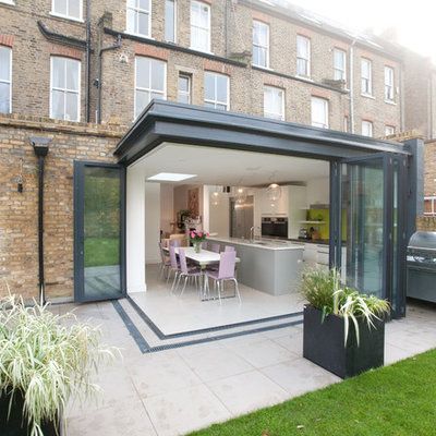 Example of a mid-sized trendy patio design in London