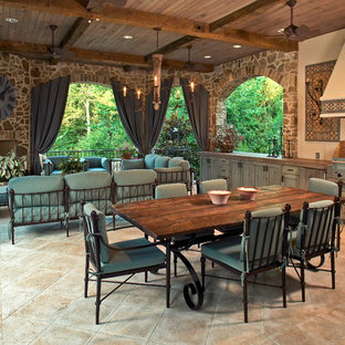 Inspiration for a timeless patio remodel in Houston with a fire pit