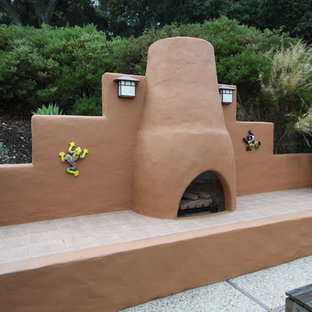 Patio - southwestern patio idea in San Francisco with a fire pit