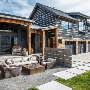 Diseño de patio rural, grande, sin cubierta, en patio delantero, con brasero y gravilla