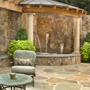 This is an example of a classic back patio in DC Metro with an outdoor kitchen.