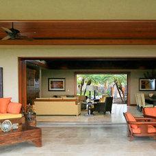 Tropical Patio by Fine Design Interiors, Inc