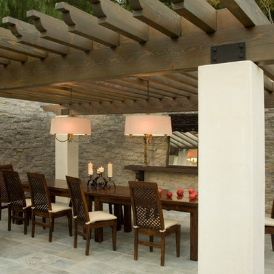 Tuscan patio photo in Los Angeles with a pergola