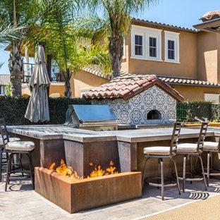 Patio - mediterranean patio idea in Los Angeles with a fire pit