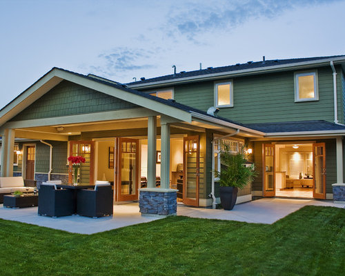 Example Of A Trendy Patio Design In Vancouver With A Roof Extension