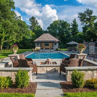 Mid-sized elegant backyard stone patio photo in Chicago