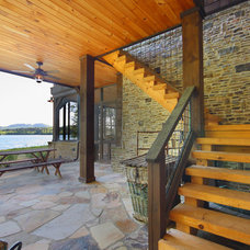 Rustic Patio by Timberlake Custom Homes, LLC