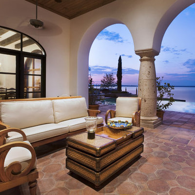 Inspiration for a mediterranean concrete paver patio remodel in Austin with a roof extension