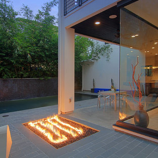 Inspiration for a contemporary patio remodel in Houston with a fire pit
