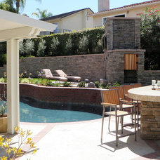 Traditional Patio by Sea Breeze Landscaping Construction