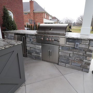 Lake Forest Outdoor Living Stone Patio with 2 Roof Structures