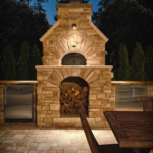 Large mountain style backyard brick patio kitchen photo in Detroit with no cover