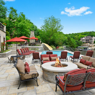 Patio - huge mediterranean backyard patio idea in Kansas City with a fire pit and no cover