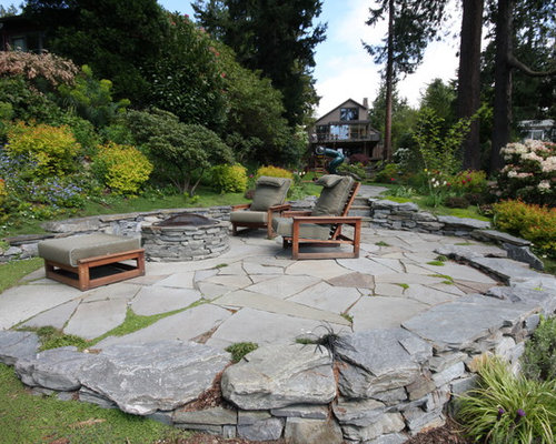 Inspiration For A Contemporary Patio Remodel In Seattle With A Fire Feature  And Natural Stone Pavers