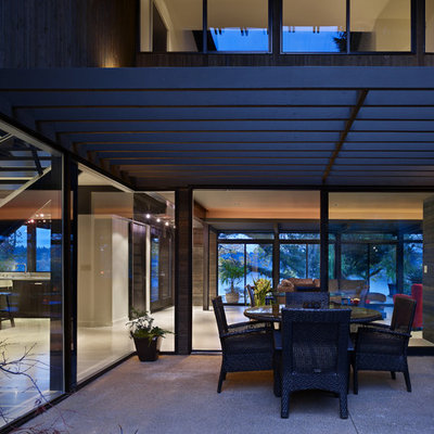 Inspiration for a contemporary patio remodel in Seattle with a pergola