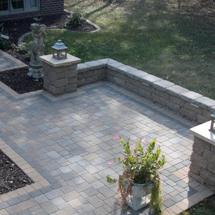 Example of a small classic front yard concrete paver patio design in Minneapolis with no cover