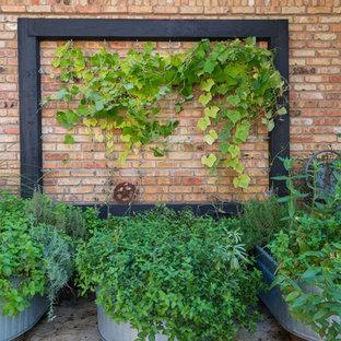 Ispirazione per un patio o portico boho chic nel cortile laterale con cemento stampato