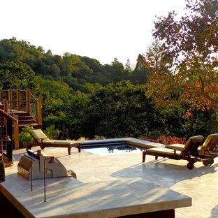 Ispirazione per un patio o portico bohémian con graniglia di granito