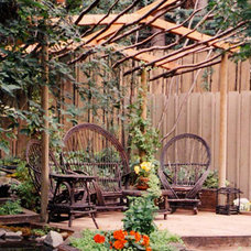 Rustic Patio by Aura Landscapers Ltd