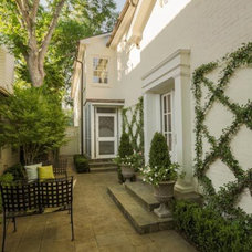 Traditional Patio by Brumley Gardens