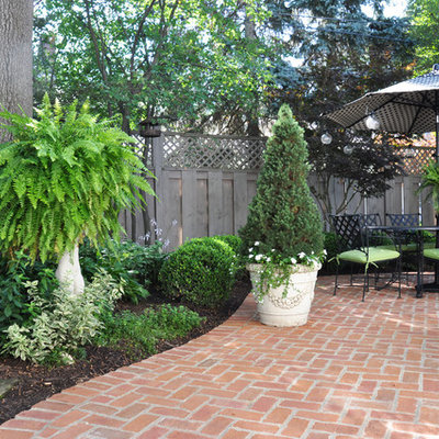Inspiration for a mid-sized timeless backyard brick patio remodel in Cleveland