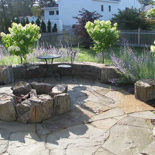 Example of a classic patio design in Portland Maine with a fire pit