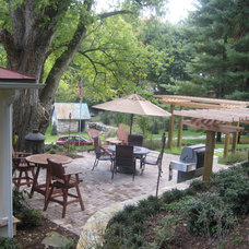 Rustic Patio by Slater Associates Landscape Architects