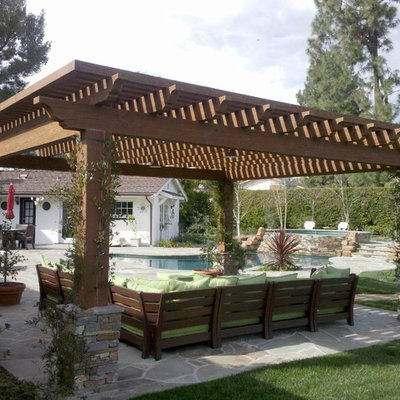Trendy patio photo in Los Angeles with a pergola