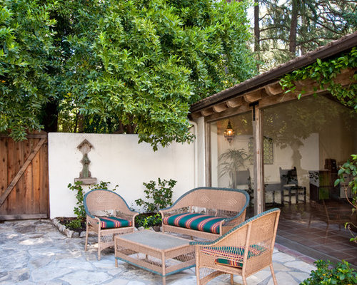 Inspiration For A Mediterranean Stone Patio Remodel In Los Angeles