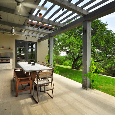 Example of a trendy patio design in Austin with a pergola