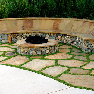 Example Of A Tuscan Stone Patio Design In San Diego With A Fire Pit
