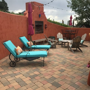 Inspiration for a large courtyard patio in Denver with concrete pavers.