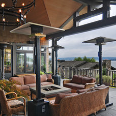 Rustic Patio by RGN Construction