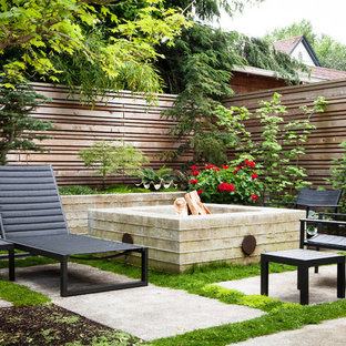 Small transitional backyard concrete paver patio photo in Portland with a fire pit and no cover