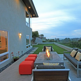 Patio - contemporary backyard patio idea in Orange County with a fire pit