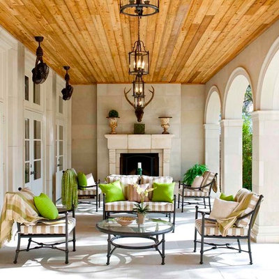 Example of a classic patio design in Dallas with a fire pit