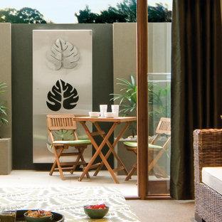 Small trendy courtyard concrete paver patio photo in Melbourne
