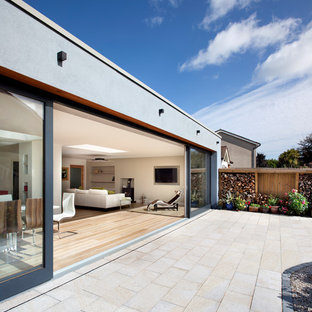 Inspiration for a large modern back patio in Dublin with no cover.