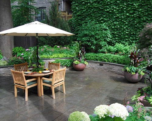 Mid Sized Elegant Backyard Stone Patio Photo In Chicago